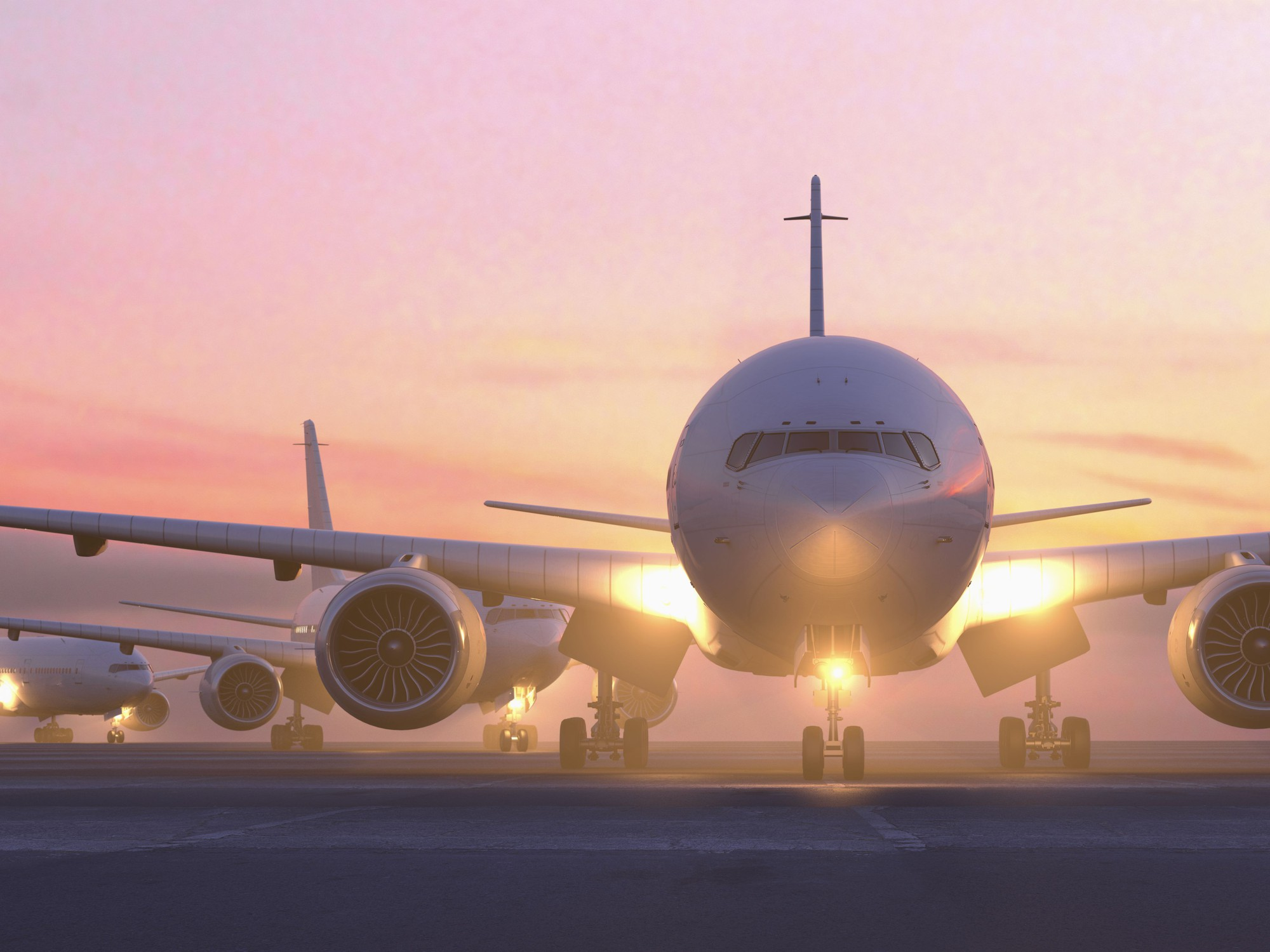airplanes-taxiing-on-runway-at-sunset-685007399-5a7cd2b1fa6bcc0037137e1d