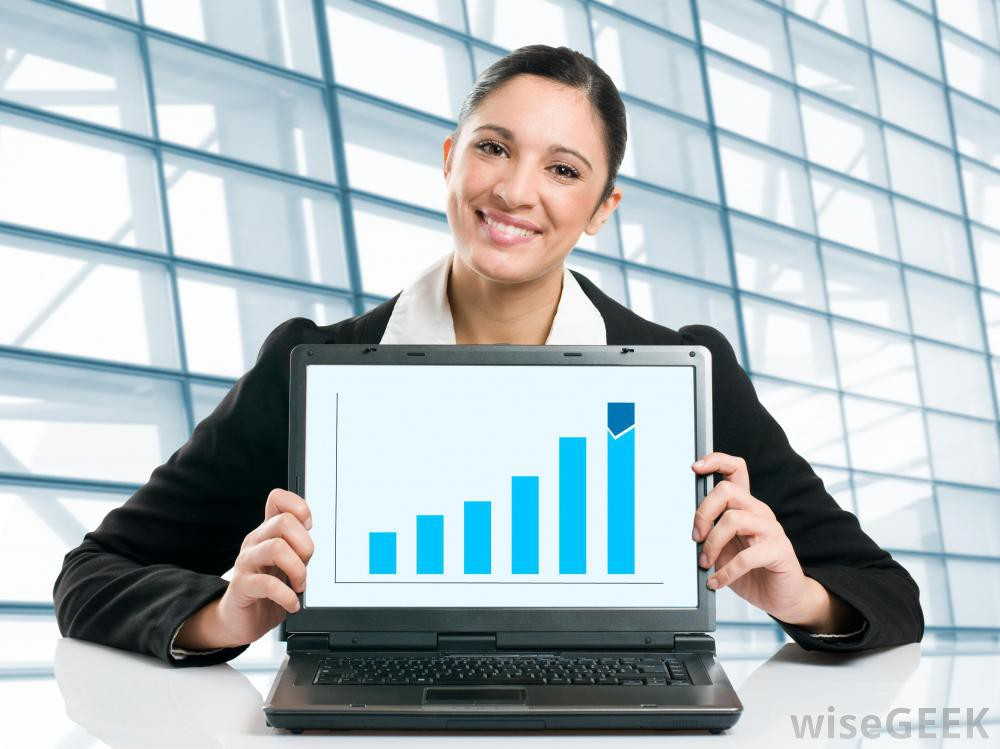 woman-holding-business-growth-chart-on-laptop