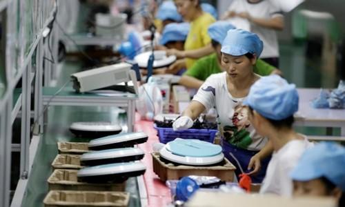 Nhà máy Trung Quốc giảm sản xuất cho công ty Mỹ - Ảnh 1.