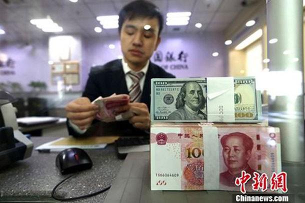 Trung Quốc tăng dự trữ vàng 9 tháng liên tiếp - Ảnh 1.
