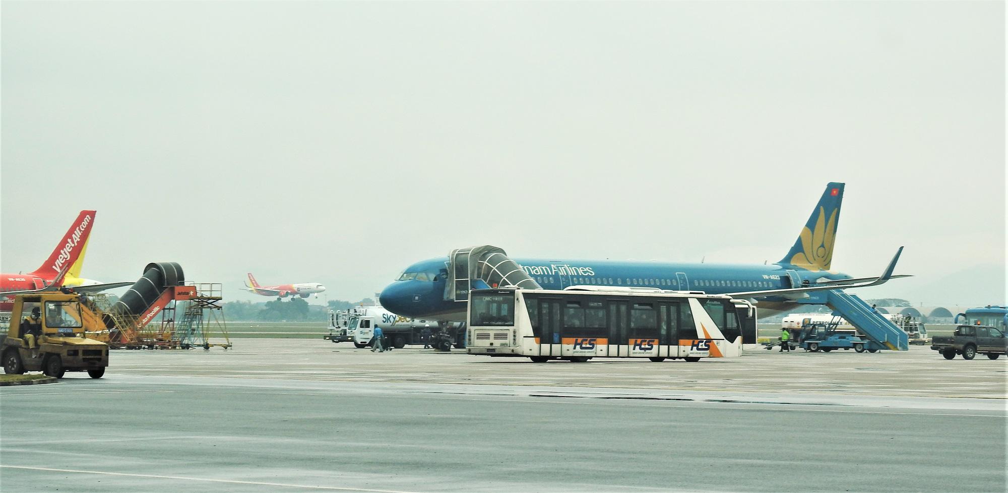 Dừng mọi chuyến bay giữa Việt Nam và Trung Quốc từ chiều nay 1/2 để ứng phó với dịch virus corona - Ảnh 1.