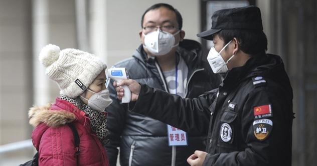 Khi Trung Quốc hắt hơi, thế giới cảm cúm: Dịch viêm phổi cấp do virus corona có thể là đòn giáng mới lên kinh tế Trung Quốc và thế giới - Ảnh 1.