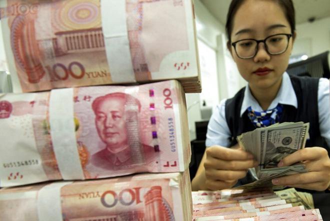 Nhân viên ngân hàng Trung Quốc được trả lương gấp đôi vì virus corona - Ảnh 1.