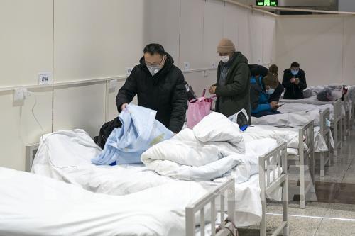 Dịch do virus corona: Tỉ lệ khỏi bệnh tại Trung Quốc tăng đáng kể - Ảnh 1.
