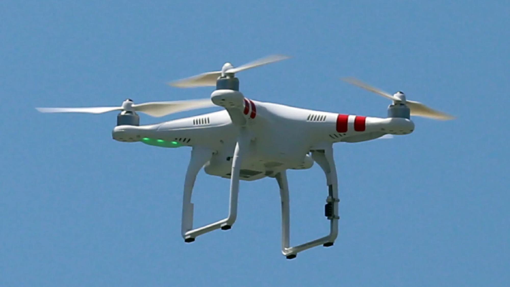 Sàn thương mại điện tử JD.com dùng trực thăng không người lái để giao hàng - Ảnh 1.