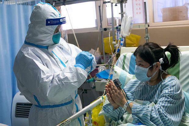 Hành trình vượt qua 'cửa tử' của một bệnh nhân nhiễm virus covid-19 ngay tâm dịch Vũ Hán - Ảnh 2.