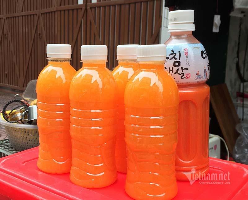 Ngày vắt 5 tạ cam, dân vỉa hè kiếm tiền triệu mùa dịch Covid-19 - Ảnh 2.