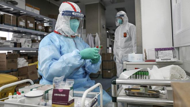 Nhóm chuyên gia WHO bắt đầu tìm hiểu dịch Covid-19 vào cuối tuần này - Ảnh 1.