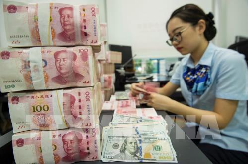 Trung Quốc hạ lãi suất công cụ cho vay trung hạn để hỗ trợ nền kinh tế - Ảnh 1.