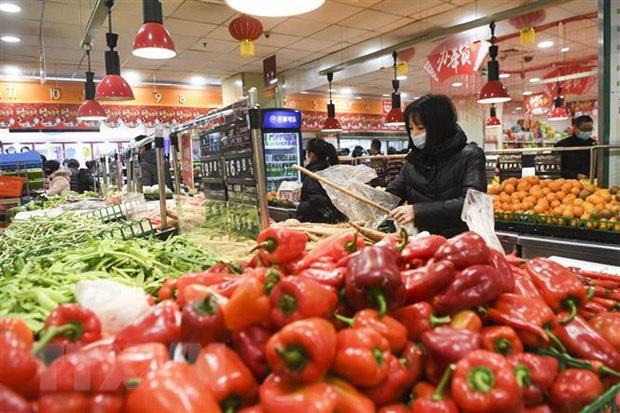 IMF hạ dự báo tăng trưởng kinh tế của Trung Quốc năm 2020 xuống 5,6% - Ảnh 1.