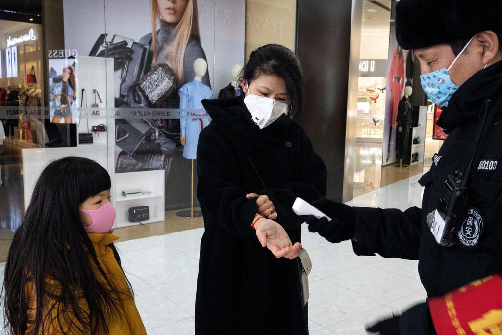 Sau Vũ Hán, Bắc Kinh cũng vắng bóng vì dịch virus corona - Ảnh 3.
