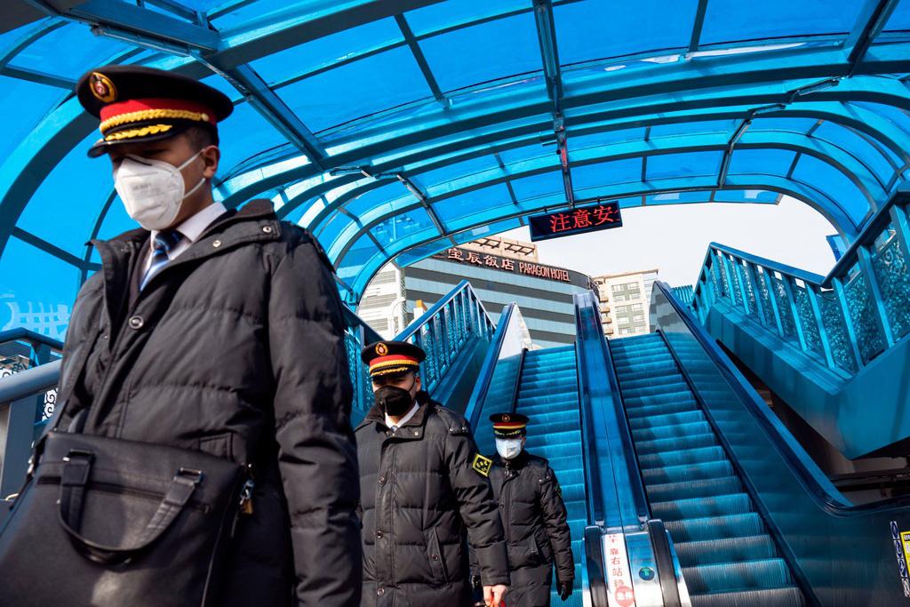 Sau Vũ Hán, Bắc Kinh cũng vắng bóng vì dịch virus corona - Ảnh 6.