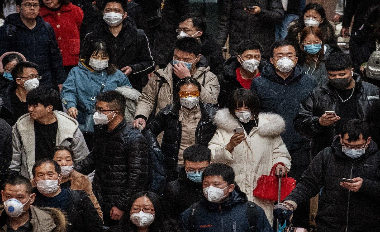 WHO tuyên bố bùng phát virus corona ở Vũ Hán không phải là đại dịch - Ảnh 1.