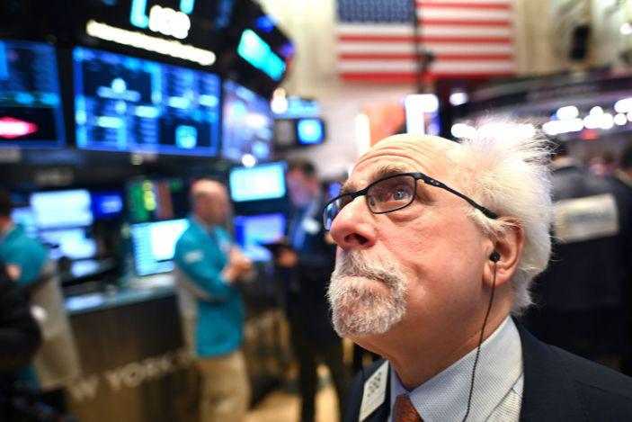 Chứng khoán Mỹ khởi sắc sau khi Fed giữ nguyên lãi suất gần 0 - Ảnh 1.