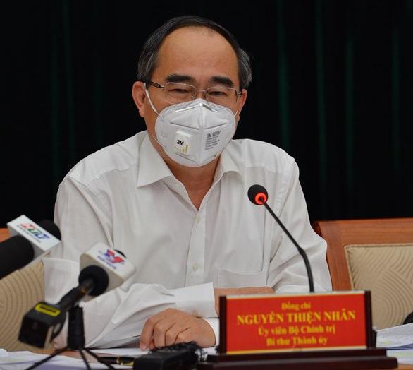 TP HCM sẽ xử phạt nghiêm người dân ra đường không đeo khẩu trang từ hôm nay - Ảnh 1.