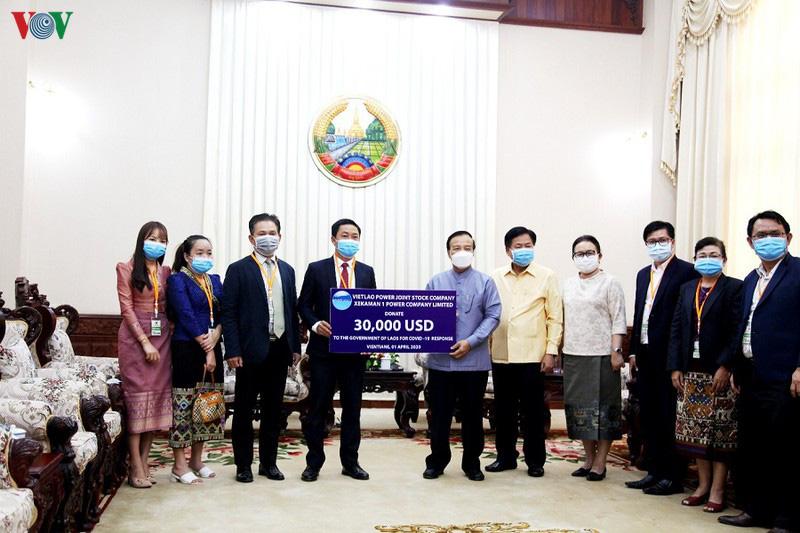 Doanh nghiệp Việt Nam ủng hộ Lào 30.000 USD chống dịch - Ảnh 1.