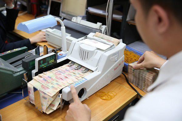 Nhiều hệ thống ngân hàng trên thế giới bị hạ bậc tín nhiệm, Việt Nam thì sao? - Ảnh 1.